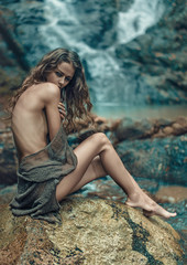 Innocent lady resting on the sharp rock