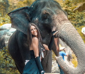 Portrait of a smiling trainer with an elephant