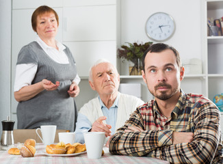 Parents arguing with son