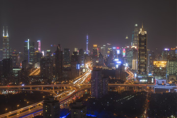 Shanghai, China - March 2, 2017: Shanghai skyline at night with the Shanghai Tower and Shanghai World Financial Center on background