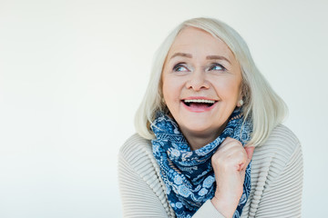 portrait of happy senior woman with makeup on white