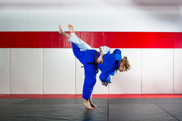 Two women fight judo on tatami