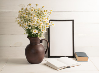Daisy bouquet in clay jug with  motivational frame in scandinavian style