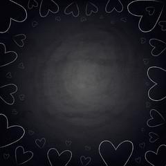 Handdrawn hearts on blackboard chalkboard background