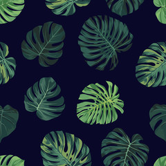 Vector seamless pattern with green monstera palm leaves on dark background. Summer tropical fabric design.