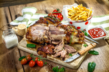 Roasted pork knuckle with french fries