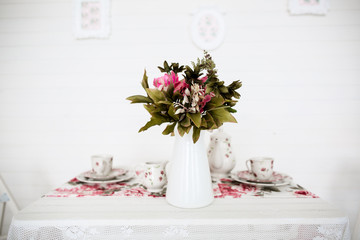 bouquet of flowers on table. White background. Vintage style.