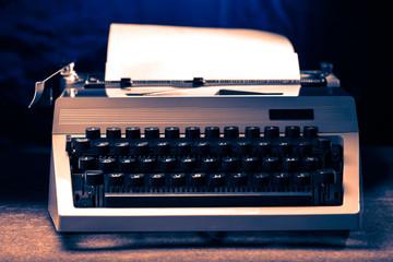 Typewriter with latin alphabet in toning