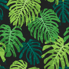vector tropical seamless pattern with monstera leaves and grunge texture on dark background.