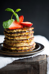 Banana pancakes with strawberries and mint