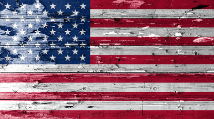 American flag on wood texture background with old paint peels