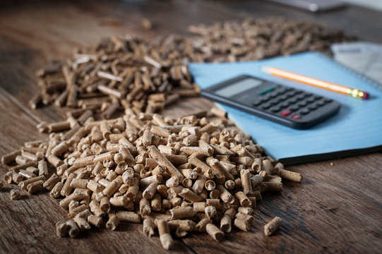 Calculating household heating costs. Wooden pellets, biomass, effective, environmentally friendly and economical heating, sustainable and renewable energy