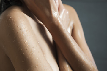 Water droplets on woman's skin
