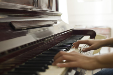 Woman's hands playing piano