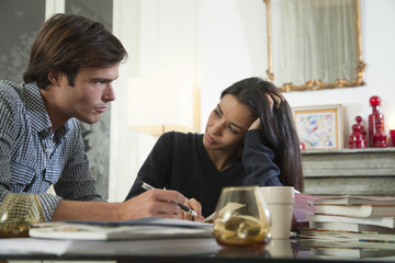 Couple reviewing their finances together