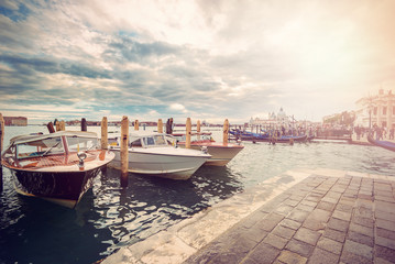 traditional venetian water taxi at St. Mark's Square, Venice, Italy, Europe, Vintage filtered style with lens flare