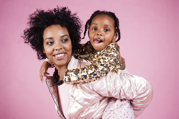 young pretty african-american mother with little cute daughter h
