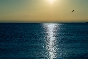 Beautiful landscape with sunlight reflection over the sea