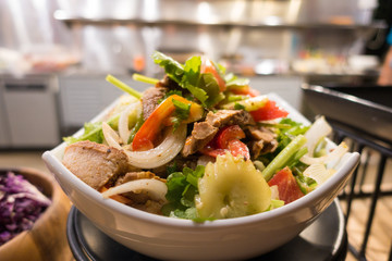 Thai's style roasted pork spicy salad with cucumber, tomato and onion