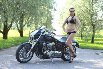 young woman in a black bikini with a motorcycle