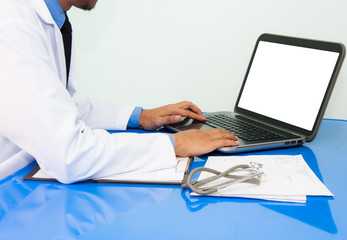medicine doctor working with computer notebook at desk in the hospital