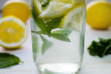 Homemade lemon juice in a bottle with mint