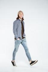 Vertical image of Hipster walking in studio