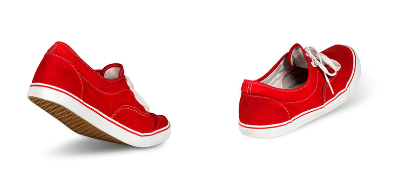 empty red ghost shoe sneaker walking away isolated on white background / Geisterschuhe rot laufen gehen isoliert