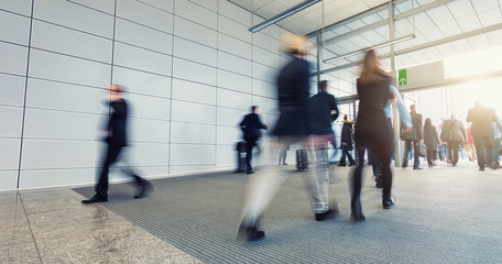 blurred business people in a modern entrance floor