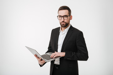 Handsome businessman using laptop computer.