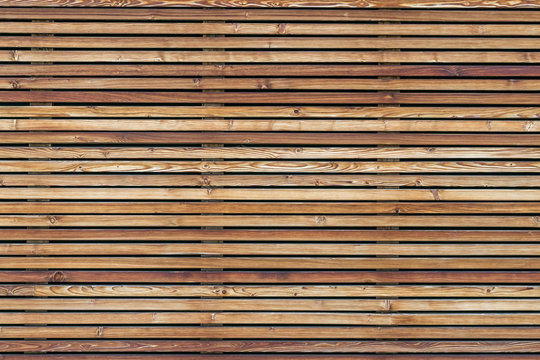 Texture of a modern wooden wall made of slats