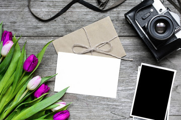 blank greeting card and envelope with retro camera, blank photos and tulip flowers