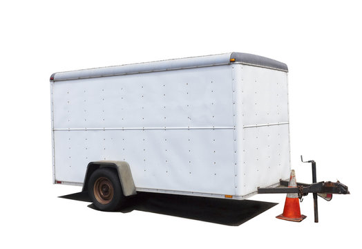 Isolated side and rear view of  white two wheel utility trailer.