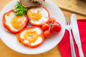 Aluminium Prints Egg Fried eggs in paprika served on white plate