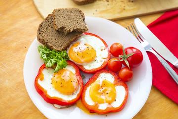 Foto op Canvas Gebakken Eieren Fried eggs in red peppers