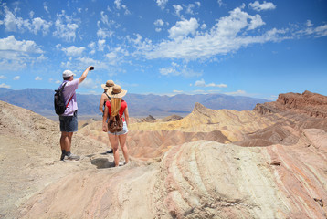 Family hiking in the mountains. Father taking photos with his phone. Death Valley National Park , eastern California and Nevada, USA.