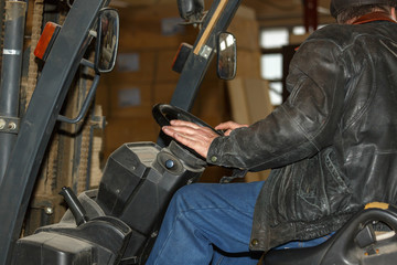 Men's hands on the the steering wheel