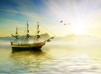 Sailing ship sailing in wavy sea at sunset time.
