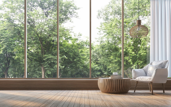 Modern living room with nature view 3d rendering Image. There are decorate room with wood. There are large window overlooking the surrounding nature and forest
