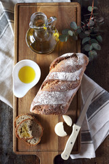 French country bread, cheese and olive oil. Top view