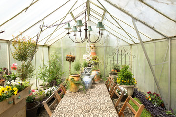Chandelier over dining table in greenhouse