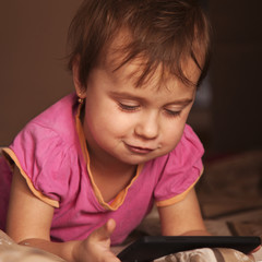 Little beautiful  girl with her smart phone (Development, education, technology, information)