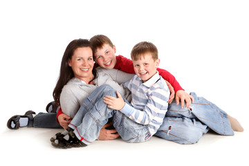Two Sons Sit next to their mother on the White Background