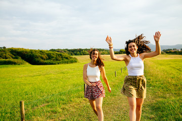 Funny friends jumping in nature