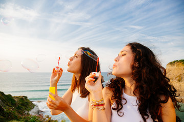Girls blowing bubbles