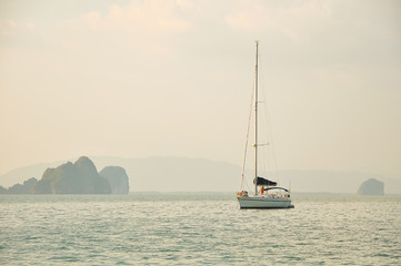 Sailing yacht in the sea among the islands