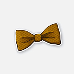 Vector illustration. Hipster checkered retro bow tie. Vintage elegant bowtie. Sticker in cartoon style with contour. Decoration for greeting cards, patches, prints for clothes, badges, emblems