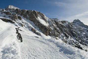 landscape: electric bicycle, e-bike, mountain bike on the snow of the mountains of Val formazza, Riale, Alps, Italy