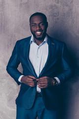 Portrait of handsome bearded afroamerican man in formalwear fasten jacket