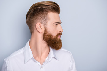 Poster Kapsalon Side view portrait of confident bearded man with beautiful hairstyle in white shirt looking on copy space